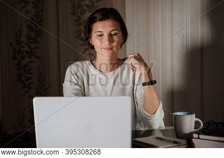 Female Student Freelancer Working At Home On A Task
