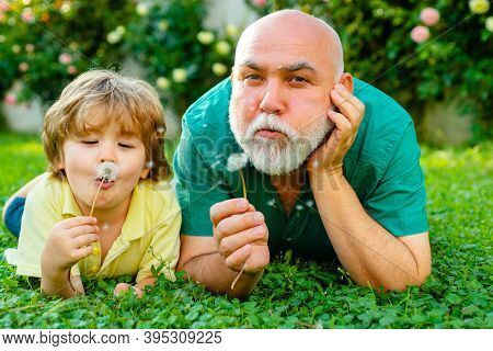 Happy Grandfather And Grandson Relaxing Together. Family Summer And Active Holidays. Cute Boy With D