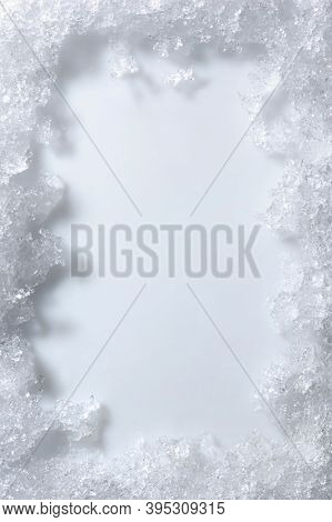 Artistic frame made from snow and ice over white background