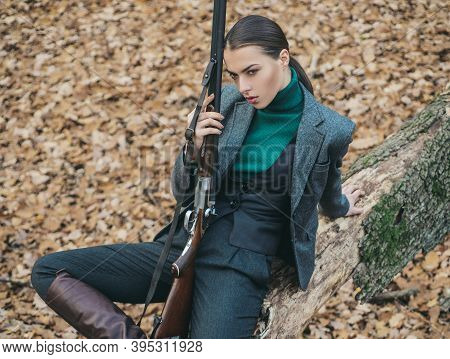 Girl With Rifle. Chase Hunting. Gun Shop. Successful Hunt. Hunting Sport. Woman With Weapon. Target