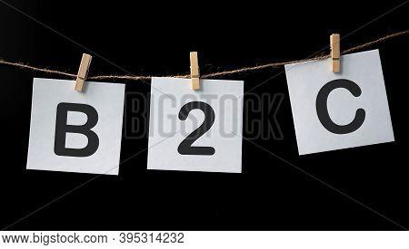 B2c , Business To Customer Marketing, On White Notes On Black Background