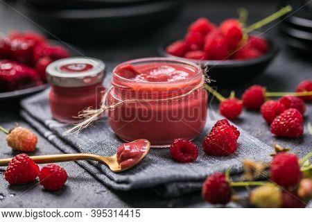 Homemade Raspberry Jam Or Confiture. Homemade Raspberry Jam In A Glass Jar And Fresh Raspberries