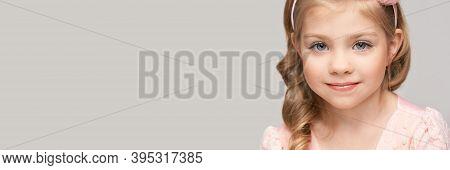 Little Pretty Girl Portrait. Studio Shot. Cute Kid Face. High Quality Photo. Smiling Children. Blond