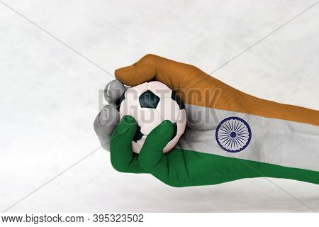 Mini Ball Of Football In India Flag Painted Hand On White Background. Concept Of Sport Or The Game I