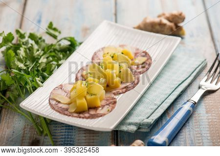 octopus carpaccio with potatoes parsley and ginger
