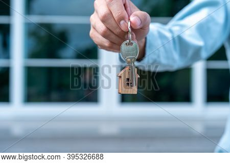 The Landlord Or Sales Representative Handing Over The Key To The New Landlord. New House Move Ideas,