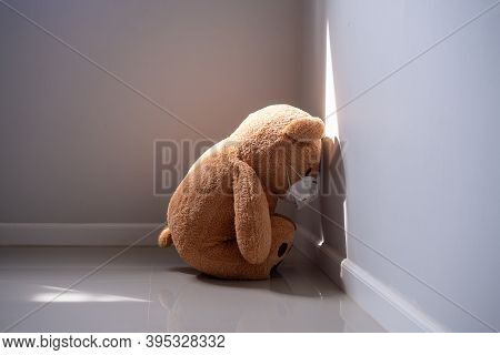 The Teddy Bear Was Sad And Disappointed. A Teddy Bear Wears A Surgical Mask To Protect Against The C