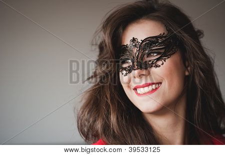 Smiling young girl masked looking away