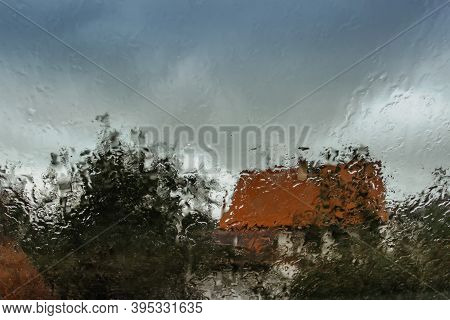 Drops On Glass In Rainy Day.rain Outside Window In The Countryside. Texture Of Raindrops, Wet Glass.