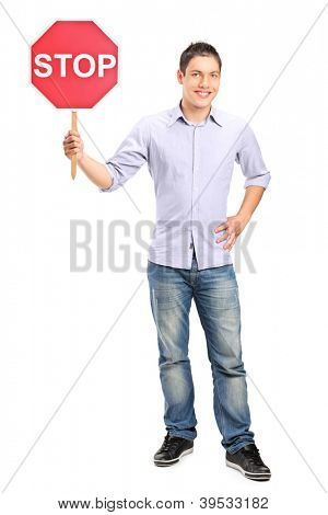 Full length portrait of a man holding a traffic sign stop isolated on white background