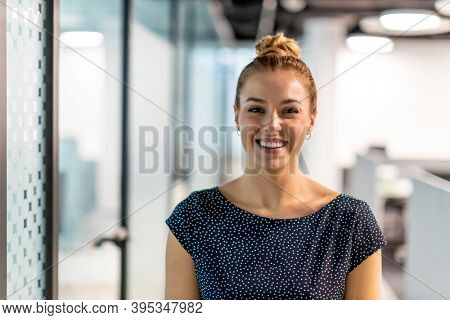 Portrait of a smiling young businesswoman in a modern office