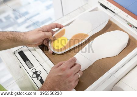 Podiatrist Making Foot Orthotics For His Client's Shoes