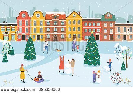 People Walk In The Park In Winter. Men, Women And Children Doing Winter Activities. Winter Cityscape