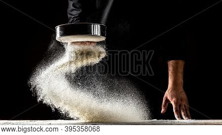White Flour Flying Into Air As Pastry Chef In White Suit Slams Ball Dough On White Powder Covered Ta