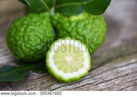 Fresh Bergamot Fruit, Kaffir Lime, Citrus Bergamia With Leaf On Wooden Table / Slice Bergamot Citrus