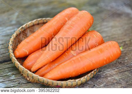Carrot On Basket, Fresh Carrot For Cooking Vegetarian On Wooden Table In The Kitchen