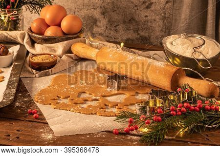 Making Christmas Gingerbread Cookies. Raw Dough In Shape Of Gingerbread Man, Christmas Tree, Star, S