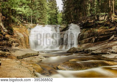 Beautiful Spring View Of Mumlava Waterfall In Krkonose, Czech Republic. Cascades Of Flowing Water On