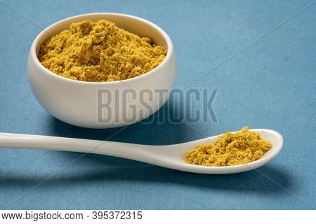 bee pollen powder loaded with protein, essential amino acids, vitamins, and antioxidants - small ceramic bowl and teaspoon