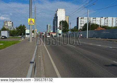 Multi-lane Highway In The City. A Road With Multi-storey Buildings.