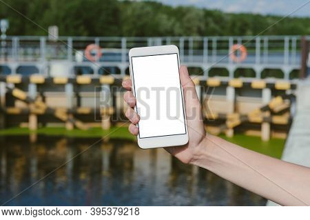 Mock-up Of A Smartphone On The Background Of The Crossing Over The Waterworks