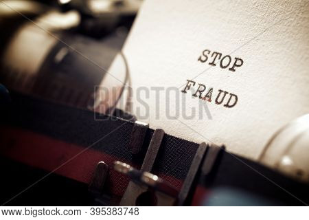 Stop fraud phrase written with a typewriter.