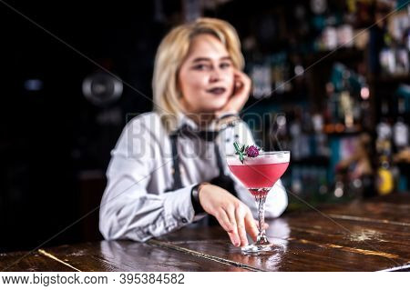 Girl Bartender Mixes A Cocktail On The Alehouse