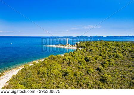 Lighthouse Of Veli Rat On The Island Of Dugi Otok, Adriatic Sea Horizon In Background, Beautiful Cro