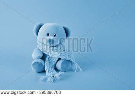 Blue Teddy Bear With Scarf On Blue Background. Blue Monday Concept.