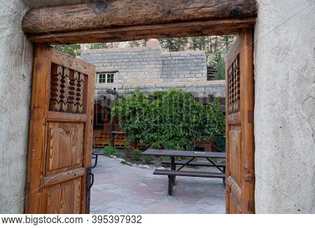 Elaborately Carved Wooden Doors At The Entrance To A Cafe And Gift Shop At Bandelier National Monume