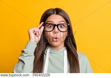 Photo Of Shocked Funny Child Girl Dressed Casual Green Outfit Arm Eyewear Lips Pouted Isolated Yello