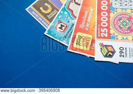 Moscow, Russia, July 2020: Close Up Of Various Russian Lottery Tickets On A Blue Background. Russian