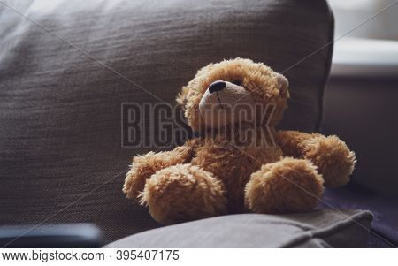 Dramatic Photo Of Teddy Bear Is Sitting On Sofa In Dark Room With Sunlight Shining From Window, Lowk