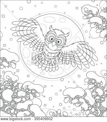 Brown Striped Owl With Big Round Eyes Flying In The Moonlit Winter Sky Over A Snowy Northern Fir For