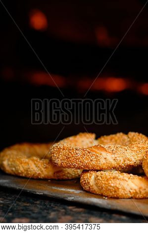 Freshly Baked Simit Baked Goods With Sesame Seeds Close-up (turkish Bagel - Gevrek Or Kuluri) In Fro