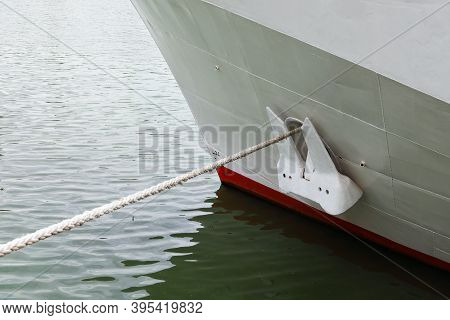 Close-up Of Waterline And Anchor Of The Ship, Mooring Line Over Water