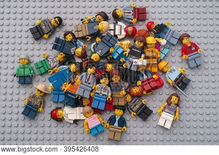 Tambov, Russian Federation - November 17, 2020 Heap Of Lego Minifigures On A Lego Baseplate.