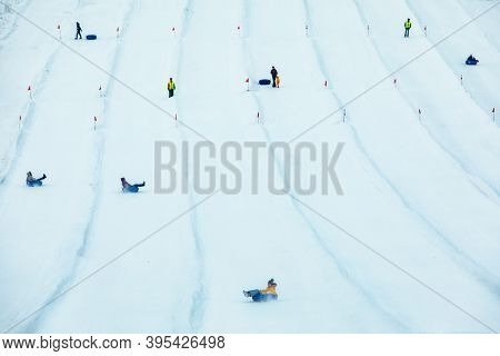 People Having Fun. Snow Tubing Down By Winter Hill