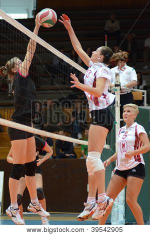 KAPOSVAR, HUNGARY - OCTOBER 14: Agnes Recsei (2nd from R) in action at the Hungarian I. League volleyball game Kaposvar (white) vs Nyiregyhaza (black), October 14, 2012 in Kaposvar, Hungary.