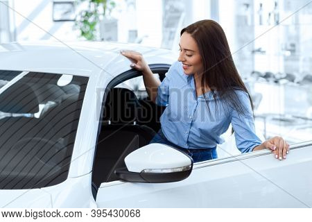 Getting Her Own Car! Beautiful Young Happy Woman Getting Inside Of A New Car She Is Going To Buy At