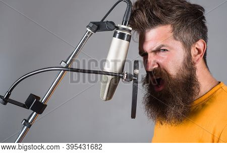 Studio Records. Bearded Man Sing In Microphone. Karaoke. Man Singing With A Microphone. Singing In S