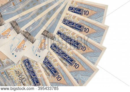 10 Tunisian Dinars Bills Lies Isolated On White Background With Copy Space Stacked In Fan Shape Clos