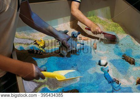 Kids Play With Augmented Reality Sandbox. Interactive Sandbox, Educational And Entertaining World Fo