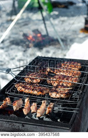 Winter Barbecue Outdoors, Grill Steak And Fork With Meat Over Hot Coals In Bbq At Campside Cookout,