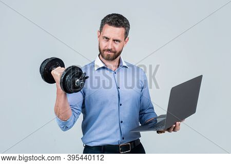 Online Work Gym That Helps Spur Productivity. Manager Hold Laptop Curling Dumbell. Strength Training