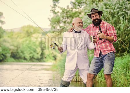 Party Go. Hobby And Sport Activity. Two Fishermen With Fishing Rods. Retired Businessman. Male Frien