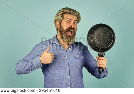 Frying Without Oil. Professional Kitchenware. Nonstick Pan For Frying. Enameled Cooking Vessels. Man