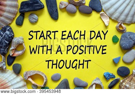 Text 'start Each Day With A Positive Thought' On A Beautiful Yellow Background. Sea Stones And Seash