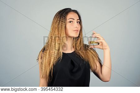 Be Impossible To Forget. Girl Applying Perfume. Eau De Toilette. Getting Fresh. Woman With Bottle Of