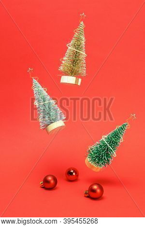 Winter Background Red. Silver, Golden And Green Winter Tree Fall With Red Balls And Sparkling Lights